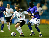 Photo: Tom Dulat/Sportsbeat Images.<br /> <br /> Millwall v Swansea City. Coca Cola League 1. 06/11/2007.<br /> <br /> Ali Fuseini of Millwall and Thomas Butler of Swansea City with the ball.