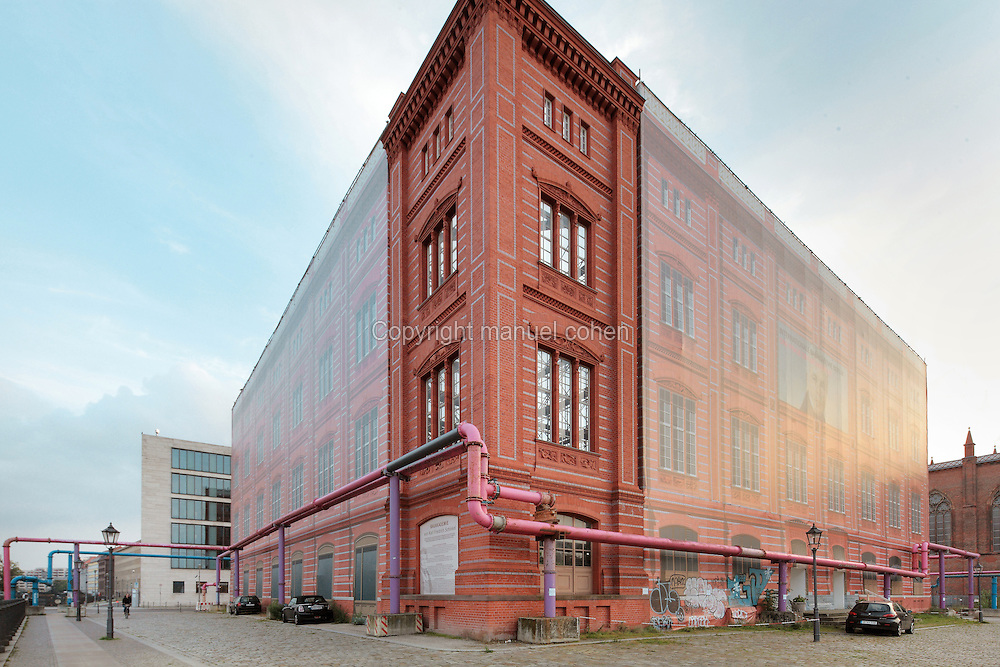 Bauakademie or Building Academy, originally built 1832-36 by Karl Friedrich Schinkel, home to architectural institutions and universities until it was demolished in 1962 and in 2000 this temporary structure was built resembling the original building, while plans to rebuild it are discussed, Berlin, Germany. The pink pipes are used for pumping water out of the ground during construction works, as the water table is so high. Picture by Manuel Cohen