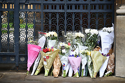 © Licensed to London News Pictures. 31/03/2018. Cambridge, UK.  Flowers left at Caius college ahead of The funeral of Stephen Hawking at Church of St Mary the Great in Cambridge, Cambridgeshire. Professor Hawking, who was famous for ground-breaking work on singularities and black hole mechanics, suffered from motor neurone disease from the age of 21. He died at his Cambridge home in the morning of 14 March 2018, at the age of 76. Photo credit: Ben Cawthra/LNP