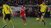 Izale McLeod getting a shot away during the Sky Bet League 1 match between Crawley Town and Colchester United at Broadfield Stadium, Crawley, England on 28 December 2014. Photo by Michael Hulf.