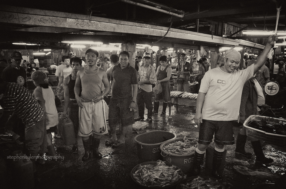 """Chaotic scene inside Fisherman's Wharf in Paranaque City at 3 AM, where the fresh catch is bought & sold based on negotiation through the practiced art of """"whispered"""" prices."""
