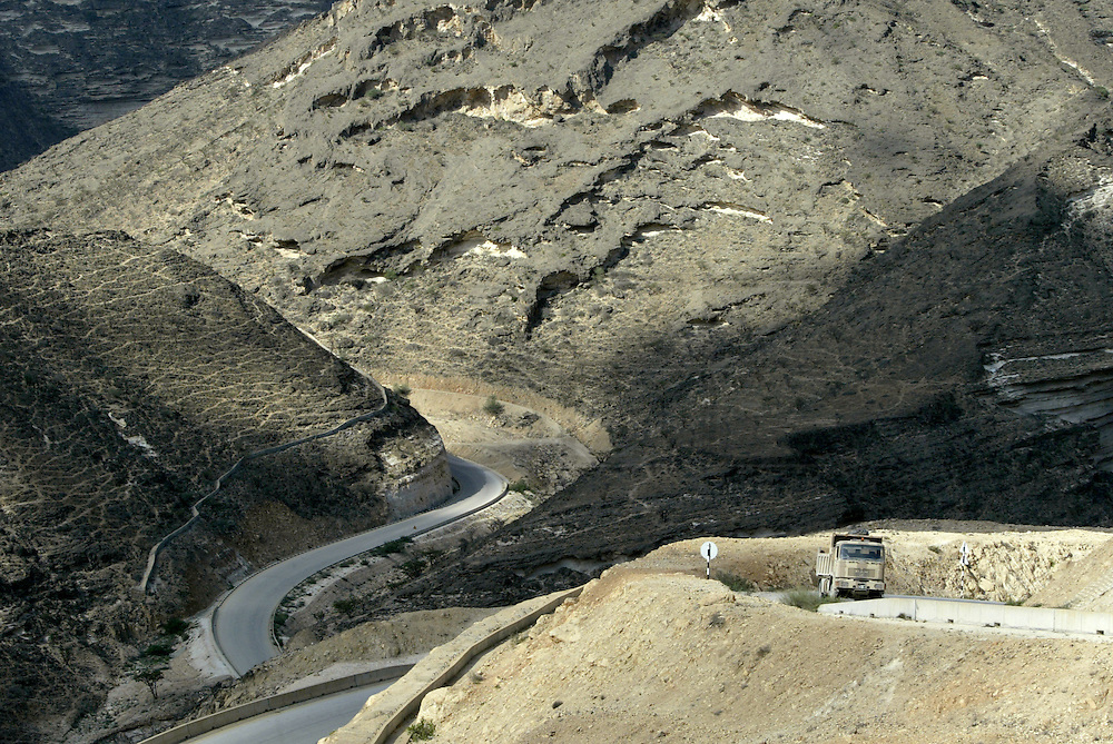 Mountain road<br /> <br /> The Sultanate of Oman is a country in Southwest Asia. It borders the United Arab Emirates in the northwest, Saudi Arabia in the west, and Yemen in the southwest.<br /> The oil discovery, in the 60's, started to transform this asleep country. Today, Oman is  torn by modern roads, industrialized and rich ( Omanization ). The tradition still dominates life of the 2,5 million inhabitants: strong religion ( muslim ), traces of tribal loyalties and a very characteristic culture.