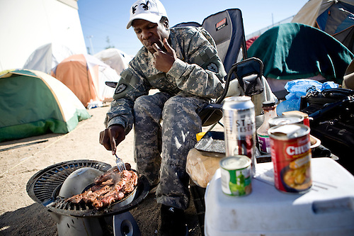 RENO NV - OCTOBER 6 A homeless man cooks breakfast in a tent city & City Of Reno Sets Up Tent City For Homeless   Max Whittaker   prime
