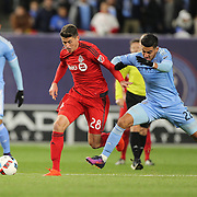 NEW YORK, NEW YORK - November 06:  Mark Bloom #28 of Toronto FC is challenged by Ronald Matarrita #22 of New York City FC during the NYCFC Vs Toronto FC MLS playoff game at Yankee Stadium on November 06, 2016 in New York City. (Photo by Tim Clayton/Corbis via Getty Images)