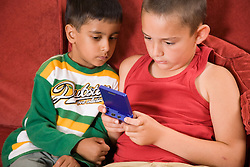 Two boys playing a computer game,,