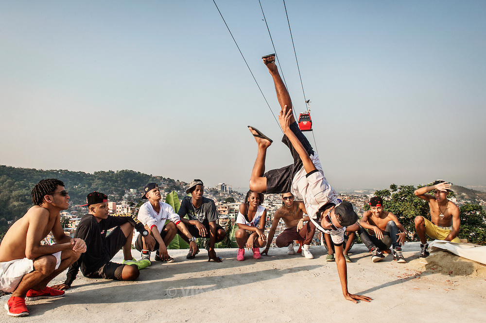 "Jackson ""Fantástico"". Rehearsal of the show ""Na Batalha"" on a rooftop of the Complexo do Alemão favelas. Elite dancers of the ""Passinho"" (little step) the newest dance fever that came out the Baile Funk culture."
