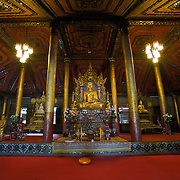 The interior of the beautiful teak Burmese style Wat Nantaram..Wat Nantaram is located at Ban Don Chai, Amphoe Chiang Kham, Phayao, Thailand. It was designed in Burmese style. The whole structure of its vihara was built from teak and decorated with fine carved wood in some parts such as windows, a pediment, galleries, etc.