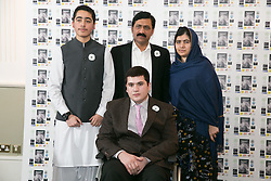 © Licensed to London News Pictures. 15/12/2015. Birmingham, UK. Malala Reception. Pictured, Brothers, Ahmad Nawaz and seated Muhammad Ibrahim with Masala Yousafzai and her father. One year on from the tragedy of the Taliban attack on the Army Public School (APS) Peshawar, Nobel Prize winner and teenage activist, Malala Yousafzai and her family hosted a special reception to mark the anniversary of one of the deadliest terrorist attacks in Pakistan.The commemorative reception held today was attended by Ahmad Nawaz and Muhammad Ibrahim Khan, two of the young survivors of the tragedy, along with Malala Yousafzai, the peace and education activist, who has made Birmingham her adopted home. As part of the commemorative ceremony, members of the public are being asked to wear a white poppy, representing the global mark of peace. Photo credit : Dave Warren/LNP