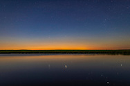 The perpetual twilight of a night near summer solstice, June 19, 2018, over a prairie pond near home. Capella, circumpolar from my latitude of 51&deg; N, is due north and reflected in the pond waters.<br /><br />A single exposure with the 35mm lens and Canon 6D MkII.