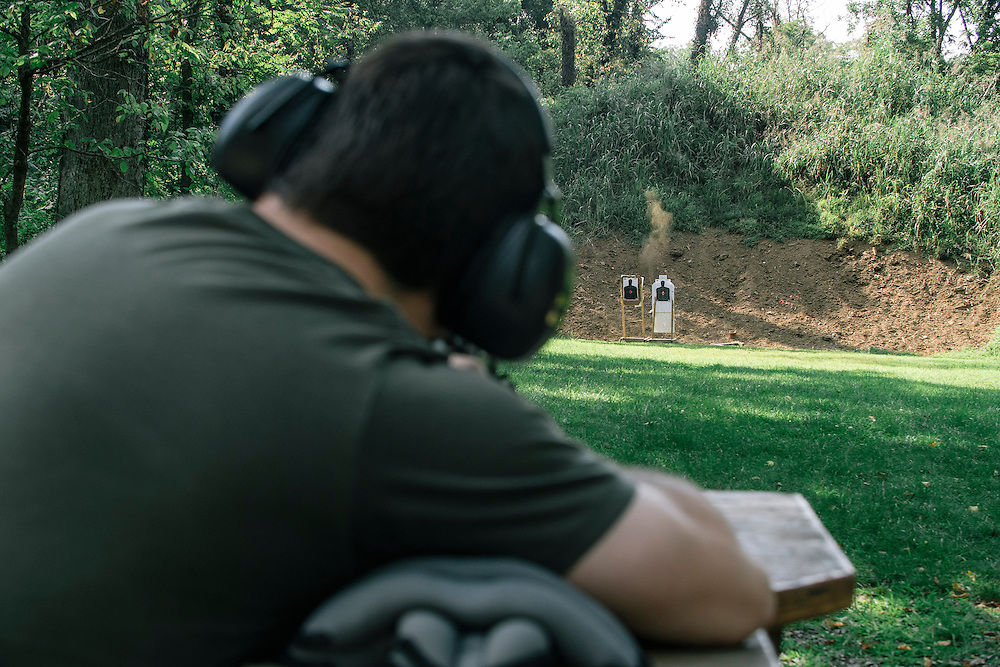 Security researcher Michael Auger fires a round from a Tracking Point TP750 rifle at a target 50 yards away. Auger and wife as well as fellow security researcher Runa Sandvik were able to hack the rifle to change the result of the tracking point.