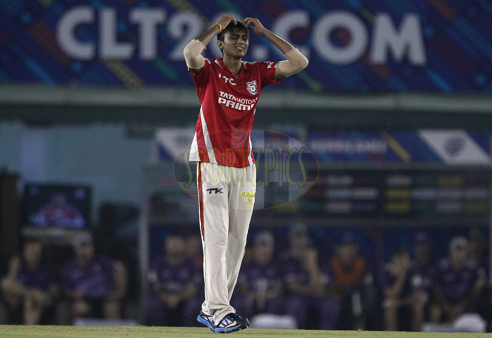 Akshar PATEL of the Kings XI Punjab  reacts after a delivery during match 2 of the Oppo Champions League Twenty20 between the Kings XI Punjab and the Hobart Hurricanes held at the Punjab Cricket Association Stadium, Mohali, India on the 18th September 2014<br /> <br /> Photo by:  Ron Gaunt / Sportzpics/ CLT20<br /> <br /> <br /> Image use is subject to the terms and conditions as laid out by the BCCI/ CLT20.  The terms and conditions can be downloaded here:<br /> <br /> http://sportzpics.photoshelter.com/gallery/CLT20-Image-Terms-and-Conditions-2014/G0000IfNJn535VPU/C0000QhhKadWcjYs