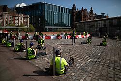© Licensed to London News Pictures. 08/04/2020. Manchester, UK. Builders working on the site practice social distances whilst they take a break . The National Health Service is establishing a 648 bed field hospital for the treatment of Covid-19 patients at the Manchester Central Convention Centre . The facility is due to open on Easter Monday , 13th April 2020 , and will treat patients from across the North West of England , providing them with medical support after discharge from Intensive Care Units . Photo credit: Joel Goodman/LNP