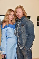 Nicky Clarke and Kelly Simpkin at a preview of the 'From Selfie To Self-Expression' exhibition at The Saatchi Gallery, Duke Of York's HQ, King's Road, London, England. 30 March 2017.