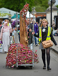© London News Pictures. 23/05/2015. London, UK. A floral design being wheeled from the venue. Members of the public carry exhibitors' plants from the 2015 Chelsea Flower show, which ends today (Sat). The Royal Horticultural Society flagship flower show has been held at the Royal Hospital in Chelsea since 1913. Photo credit: Ben Cawthra/LNP