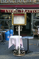 Parisian Café, outdoor tables with menu display, Paris, France<br />