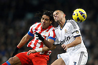 01.12.2012 SPAIN -  La Liga 12/13 Matchday 14th  match played between Real Madrid CF vs  Atletico de Madrid (2-0) at Santiago Bernabeu stadium. The picture show Radamel Falcao Garcia (Colombian striker of At. Madrid) and  Kepler Laveran Pepe (Portuguese/Brazilian defender of Real Madrid)