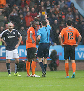 Referee Kevin Clancy yellow cards Dundee United&rsquo;s Guy Demel - Dundee v Dundee United, Ladbrokes Premiership at Dens Park<br /> <br />  - &copy; David Young - www.davidyoungphoto.co.uk - email: davidyoungphoto@gmail.com