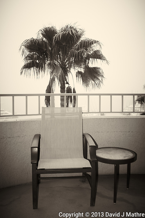 Lonely chair on the balcony in the Early Morning Fog. Image taken at the Vinoy Hotel in St. Petersburg with a Nikon 1 V1 camera and 10 mm f/2.8 lens (ISO 100, 10 mm, f/4.5, 1/250 sec). Raw image processed with Capture One 7 Pro (including conversion to B&W).