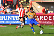 Malvind Benning (3) of Mansfield Town is challenged by Kane Wilson (20) of Exeter City during the EFL Sky Bet League 2 match between Exeter City and Mansfield Town at St James' Park, Exeter, England on 30 March 2019.