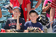 ANAHEIM, CA - MAY 14:  Two Boston Red Sox fans pose for a photo before the game against the Los Angeles Angels of Anaheim at Angel Stadium in Anaheim, California on Thursday, May 14, 2009.  The Angels defeated the Red Sox 5-4 in 12 innings.  (Photo by Paul Spinelli/MLB Photos)