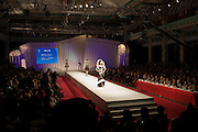 Designer clothes being modeled in opening show of China Fashion Week at the Beijing Hotel, China