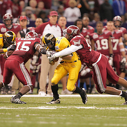 21 December 2008:  Troy defenders Dion Gales (98) and Tavares Williams (15) combine to tackle Southern Miss running back Damion Fletcher (25) during the first half of the R+L Carriers New Orleans Bowl between the Southern Mississippi Golden Eagles and the Troy Trojans at the New Orleans Superdome in New Orleans, LA.