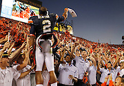 AUBURN, AL - OCTOBER 16:  Quarterback Cam Newton #2 of the Auburn Tigers celebrates with the crowd after the game against the Arkansas Razorbacks at Jordan-Hare Stadium on October 16, 2010 in Auburn, Alabama.  The Tigers beat the Razorbacks 65-43.  (Photo by Mike Zarrilli/Getty Images)