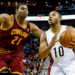 Nov 22, 2013; New Orleans, LA, USA; New Orleans Pelicans shooting guard Eric Gordon (10) drives past Cleveland Cavaliers center Andrew Bynum (21) during the second quarter of a game at New Orleans Arena. Mandatory Credit: Derick E. Hingle-USA TODAY Sports