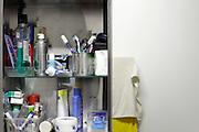 open medicine cabinet with mirror in domestic bathroom