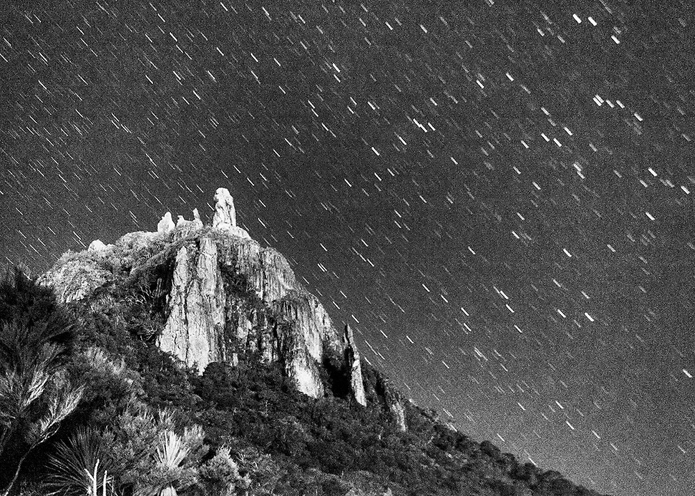 Star trails Mt Manaia (delayed exposure)<br /> <br /> Print options:<br /> <br /> PRINT:<br /> A4 - $115 (with white matt)<br /> A3 - $175 <br /> A2 - $245<br /> <br /> FRAMED PRINT<br /> A4 - $225<br /> A3 - $460<br /> A2 - $560<br /> <br /> Available to view at the Newday Cafe, Parua Bay.<br /> <br /> Contact Alan to order through the contact tab above, or at info@alansquires.co.nz<br /> <br /> N.B.<br /> All prints are signed and numbered.<br /> P&P - free within Whangarei District.<br /> The wood frames come in black or white.<br /> All black and white prints are made on archival cotton rag paper (360gsm).<br /> All colour prints are on Luster paper (260gsm).