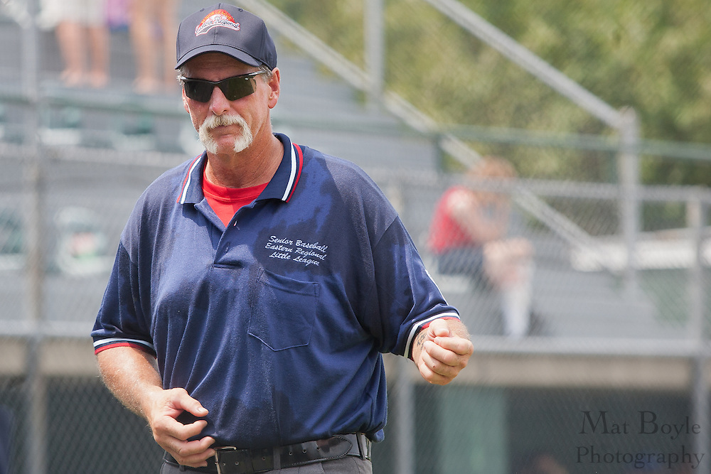 "The third-base umpire plays air guitar to ""Sweet Home Alabama"" during a elimination bracket game of the Eastern Regional Senior League tournament held in West Deptford on Sunday, August 7."
