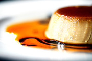 SHOT 1/6/12 3:54:31 PM - Paxia upscale Mexican restaurant in the Sunnyside neighborhood of Denver, Co. Coffee flan dessert $5.99. Crème caramel, flan, or caramel custard is a custard dessert with a layer of soft caramel on top, as opposed to crème brûlée, which is custard with a hard caramel top. (Photo by Marc Piscotty /  © 2012)