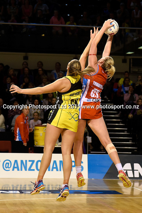 Swifts' Caitlin Thwaites (R jumps for the ball with Pulse's Te Huinga Reo Selby-Rickit during the ANZ Championship - Pulse v Swifts netball match at the TSB Arena in Wellington on Saturday the 25th of April 2015. Photo by Marty Melville / www.Photosport.co.nz
