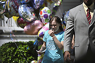 Beth Serrano, sister of Amanda Berry, wipes her eyes before speaking to the media outside of her home moments after the arrival of Berry on Wednesday, May 8, 2013, in Cleveland, Ohio..Amanda Berry, Michelle Knight and Gina DeJesus were held captive for years in a house on Seymour Avenue by Ariel Castro. © David Richard