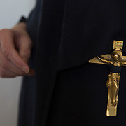 A crucifix is tied to the belt of hermit Sister Rachel Denton at St Cuthberts' Hermitage in Lincolnshire, north east Britain April 27, 2015. Sister Rachel Denton has vowed to spend the rest of her life living as a consecrated hermit in the Catholic faith. A hermit is a person who chooses to live alone, with the intention of finding God. Rarely leaving her house she lives a life of prayer and solitude. However, she uses the internet and social media to share her experience and distance her self from physically interacting with society. REUTERS/Neil Hall