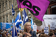 A young girl on the Royal Mile waving a flag at the start of a pro-Independence march and rally in the Scottish capital. The event, which was staged in support of the pro-Independence movement, was attended by an estimated by approximately 30,000 people. The referendum to decide whether Scotland will become an independent nation will be staged on 18th September 2014.