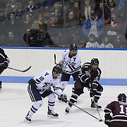 Matt Hatch, Union College, (centre, right) and Mitch Witek, Yale, challenge for the puck  during the Yale Vs Union College, Men's College Ice Hockey game at Ingalls Rink, New Haven, Connecticut, USA. 28th February 2014. Photo Tim Clayton