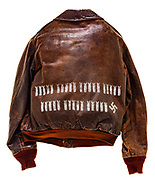 "This type A-2 flight jacket belonged to Kyle N. ""Dixie"" Anderson, a member of the 570th Squadron attached to the 390th Bomb group. On the front of the jacket is a name plate reading ""Dixie Anderson"" and the 570th Squadron insignia patch. There are 35 bombs painted on the back of the jacket signifying the 35 missions he completed. There is also one swastika painted on the back signifying a destroyed enemy aircraft. Anderson also served in the Korean and Vietnam wars, amassing a total of 211 completed mission before retiring in 1969."