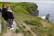 Alex and Julie Ann with O'Brien's Tower in the background at The Cliffs of Moher in County Clare, Ireland on Friday June 21st 2013. (Photo by Brian Garfinkel)