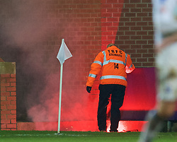 BIRKENHEAD, ENGLAND - Saturday, January 3, 2015: A steward fails to put out a red flare, set off by Swansea City supporters as they celebrate their side's 6-2 victory over Tranmere Rovers, during the FA Cup 3rd Round match at Prenton Park. (Pic by David Rawcliffe/Propaganda)
