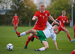 WREXHAM, WALES - Wednesday, October 30, 2019: Wales' Aaron Bennett is tackled by Republic of Ireland's Corey McLoughlin (R) during the 2019 Victory Shield match between Wales and Republic of Ireland at Colliers Park. (Pic by David Rawcliffe/Propaganda)
