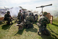 Reenactors of the NWW2A Portraying members of the 21st Panzer Division fire a replica PAK anti-tank gun during a 1940s wartime weekend at Fort Paull on Bank Holiday Monday <br /> <br /> 5 May 2013<br /> Image © Paul David Drabble