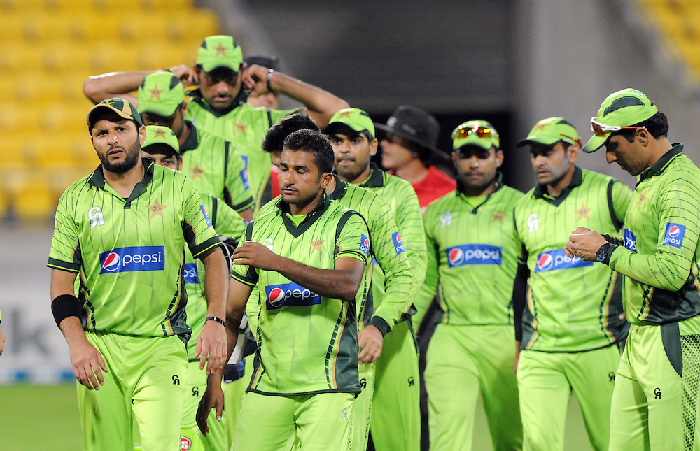 Pakistan's Shahid Afridi, left, leads the team off the field after the defeat by New Zealand in the 1st One Day International cricket match at Westpac Stadium, New Zealand, Saturday, January 31, 2015. Credit:SNPA / Ross Setford