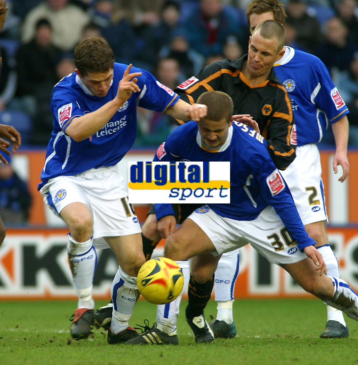 Photo: Dave Linney.<br />Leicester City v Wolverhampton Wanderers. Coca Cola Championship. 04/02/2006.No way through for Wolves's Kenny Miller(R)  Joey Gudjonsson(L)   James Wesolowski block his path