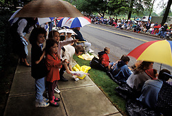 Design image spectators rainy day parade