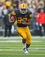 September 25 2010: Iowa Hawkeyes running back Adam Robinson (32) runs through a hole during the first half of the NCAA football game between the Ball State Cardinals and the Iowa Hawkeyes at Kinnick Stadium in Iowa City, Iowa on Saturday September 25, 2010. Iowa defeated Ball State 45-0.