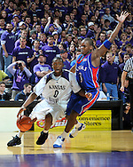 Jan 30, 2008; Manhattan, KS, USA; Kansas State Wildcats guard Jacob Pullen (0) drives around pressure from Kansas Jayhawks guard Russell Robinson (3) in the second half at Bramlage Coliseum in Manhattan, KS. Kansas State upset the 2nd ranked Kansas Jayhawks 84-75. Mandatory Credit: Peter G. Aiken-US PRESSWIRE