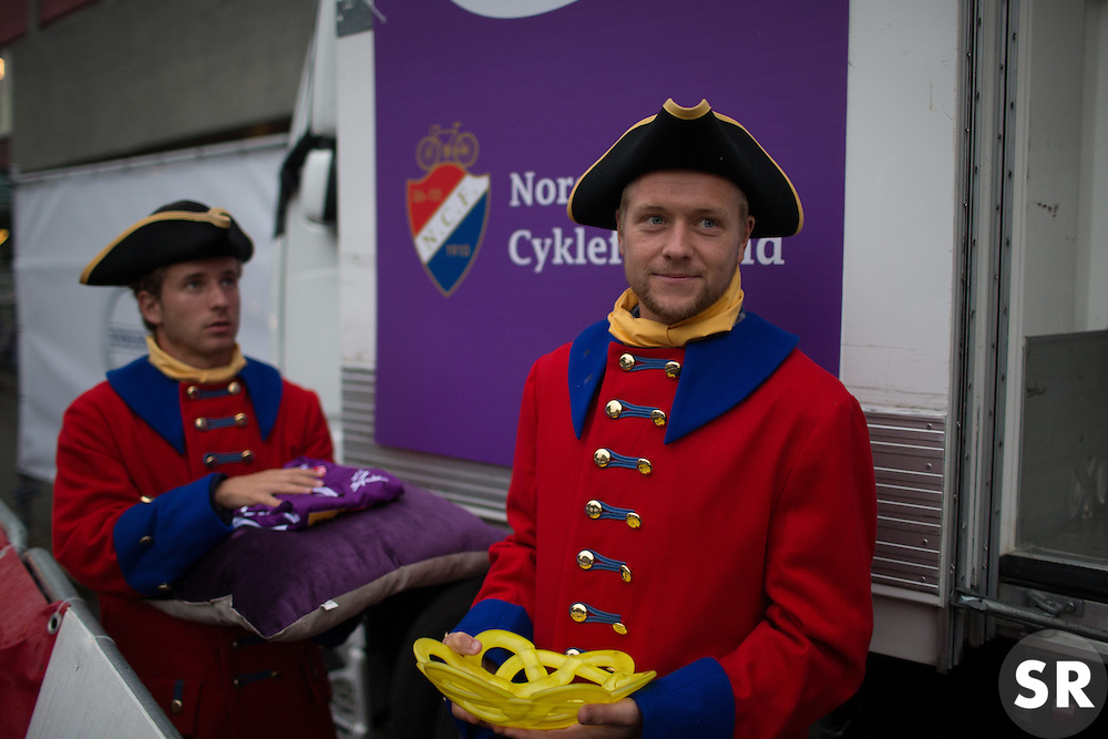 Podium boys in traditional local clothes wait to hand over jerseys and prizes after the 76,1 km first stage of the 2016 Ladies' Tour of Norway women's road cycling race on August 12, 2016 between Halden and Fredrikstad, Norway. (Photo by Balint Hamvas/Velofocus)