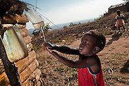 "In the Malawi village of Ntecheu, children use ""tippy taps"" to reinforce the practice of washing hands after using the toilet."
