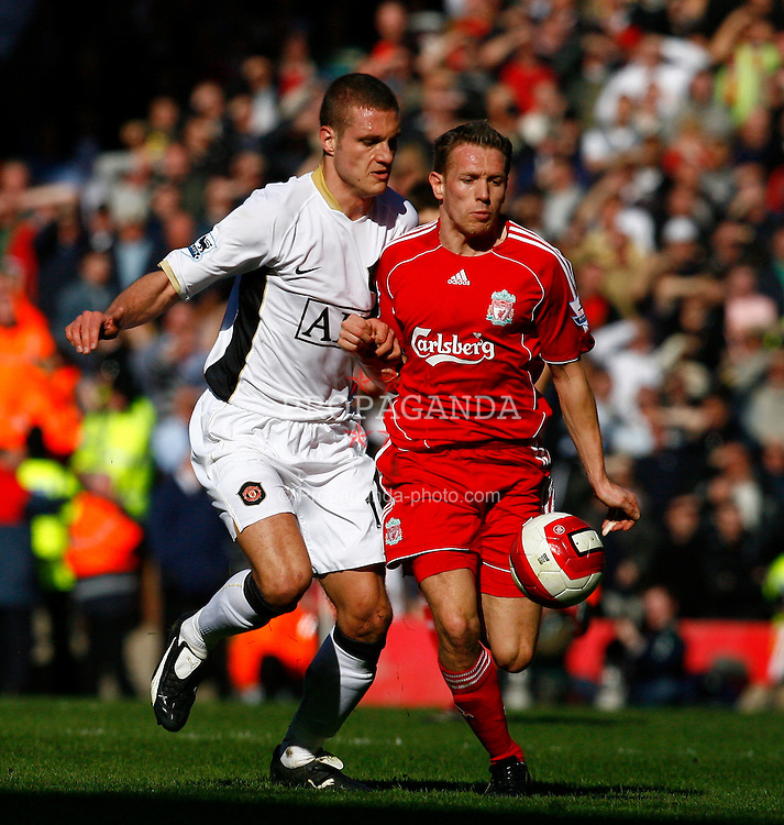 Liverpool, England - Saturday, March 3, 2007:  Liverpool's Craig Bellamy pushed by Manchester United's Nemanja Vidic during the Premiership match at Anfield. (Pic by David Rawcliffe/Propaganda)